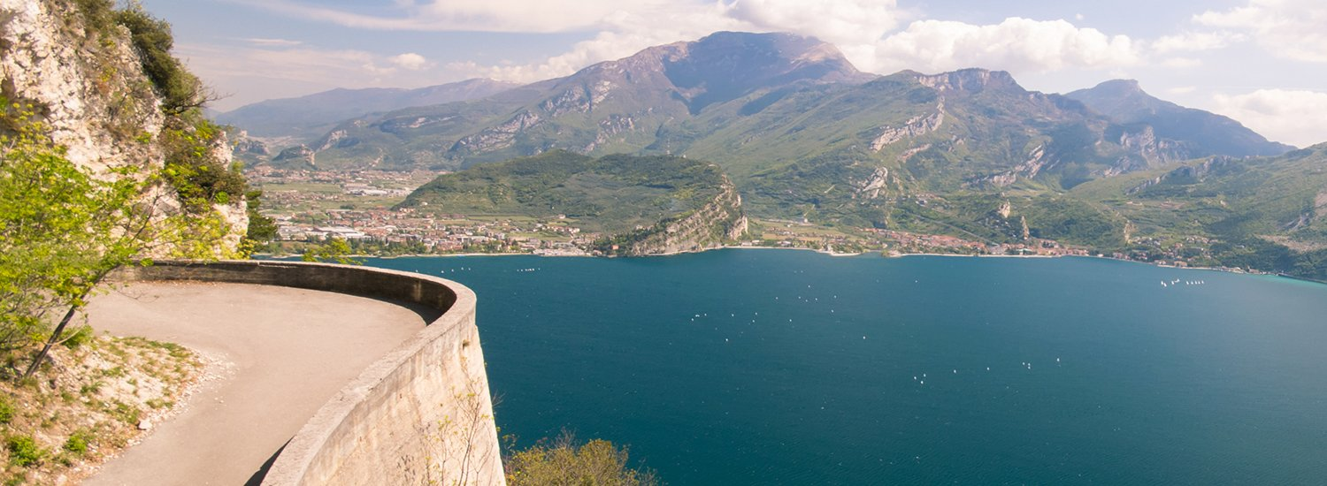 The Ponale trail carved into the rock of the mountain in Riva del Garda, Italy.